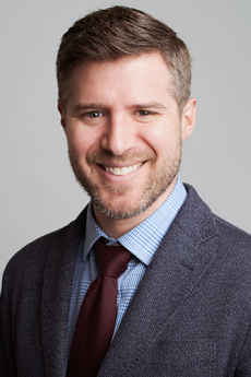Head shot of David Halliday with gray background